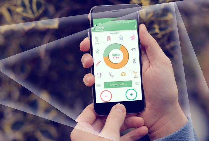En telefon med en økonomi-app på skjermen